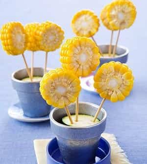 http://fabulousfoodblog.com/2013/01/16/corn-flowers-its-hard-for-little-kids-to-handle-a-whole-ear-of-corn-but-eating-scraped-off-kernels-isnt-as-much-fun-as-this/